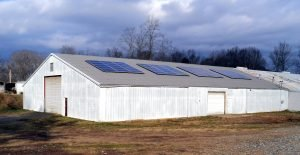 Brewery solar energy system on barn metal roof standing seam